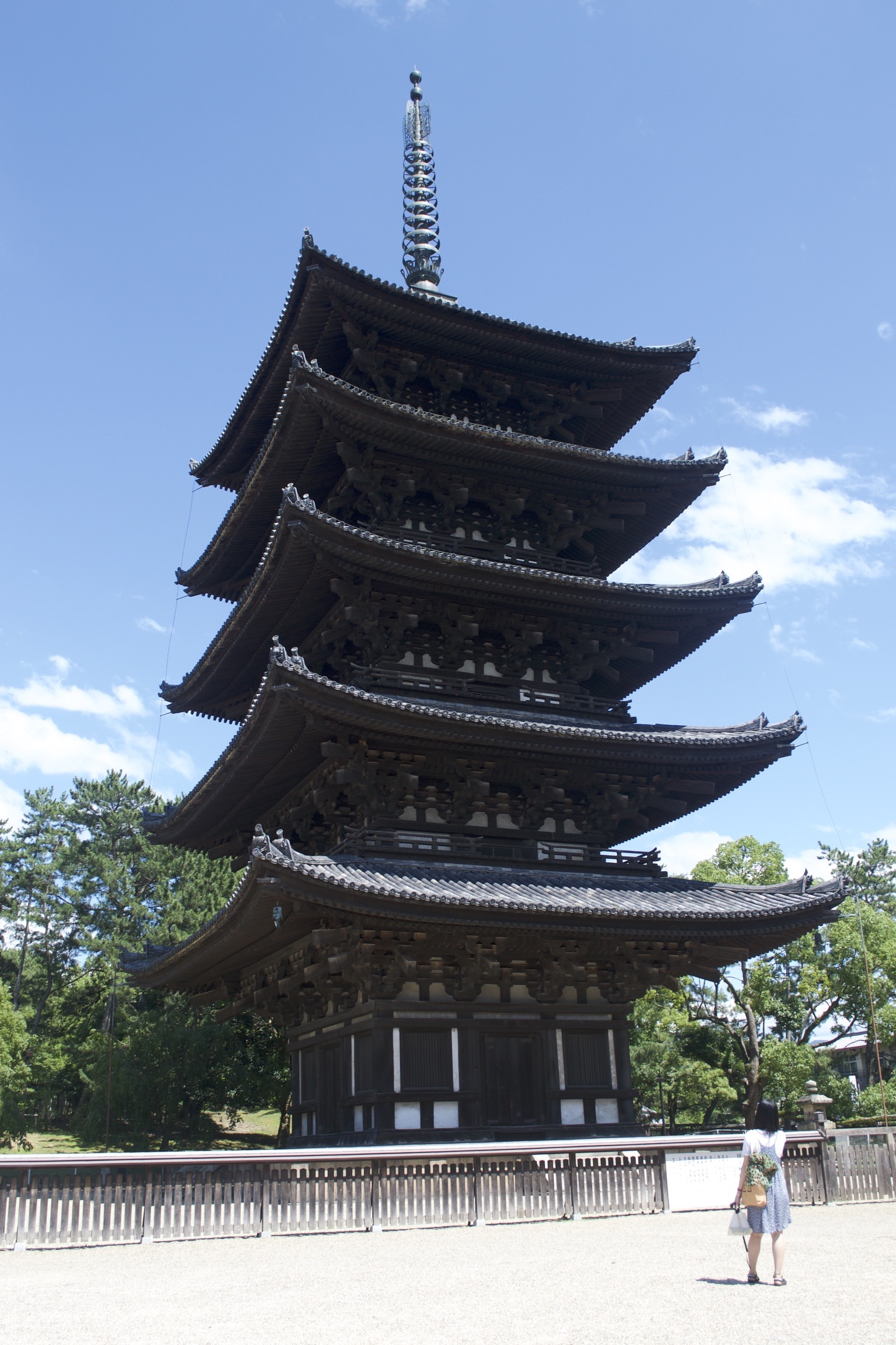 A five-story pagoda with a metal antenna.
