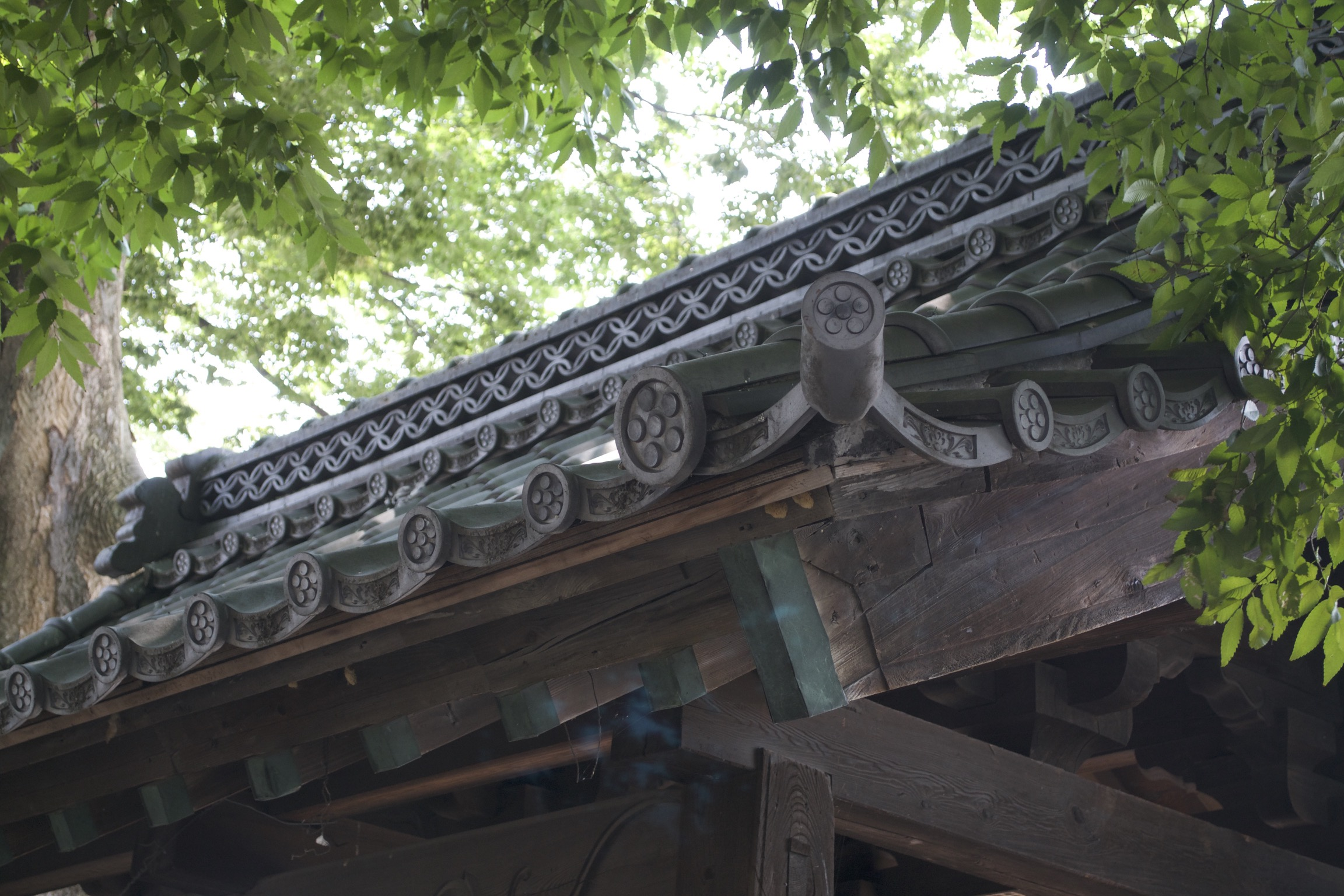 A closeup of roof tiles on a nearby temple.
