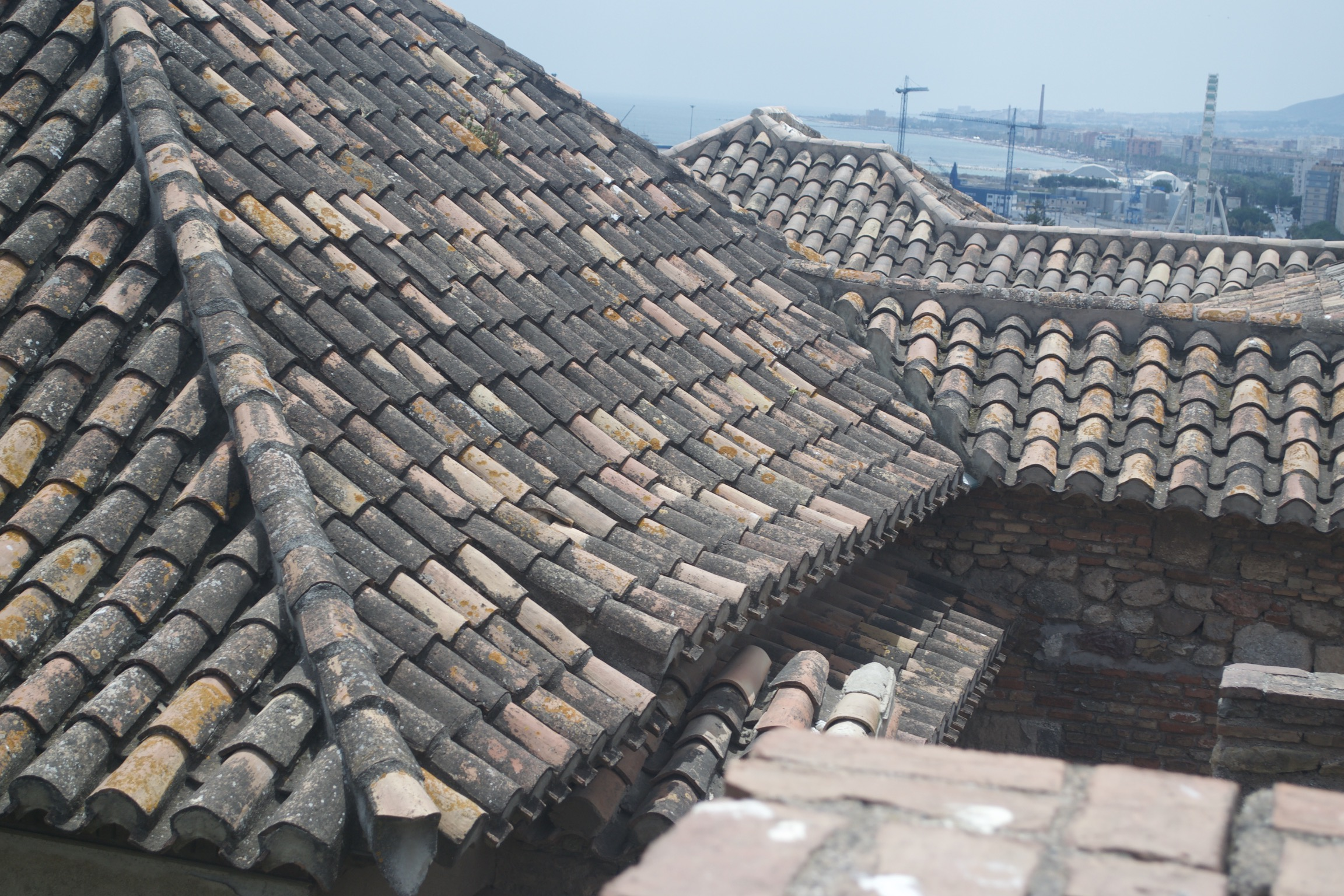 Tiled roofs meet, yielding complicated joints and eaves.