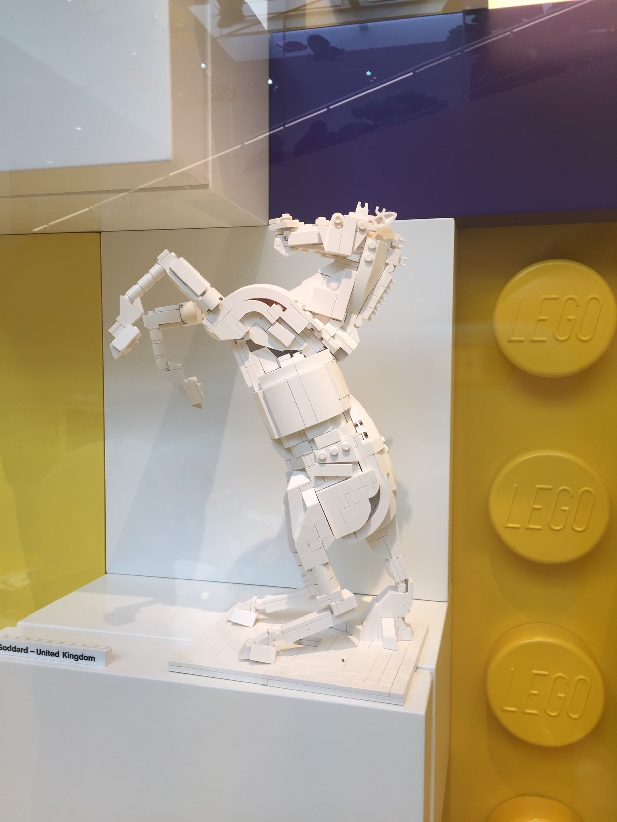A rearing horse made of white LEGO.