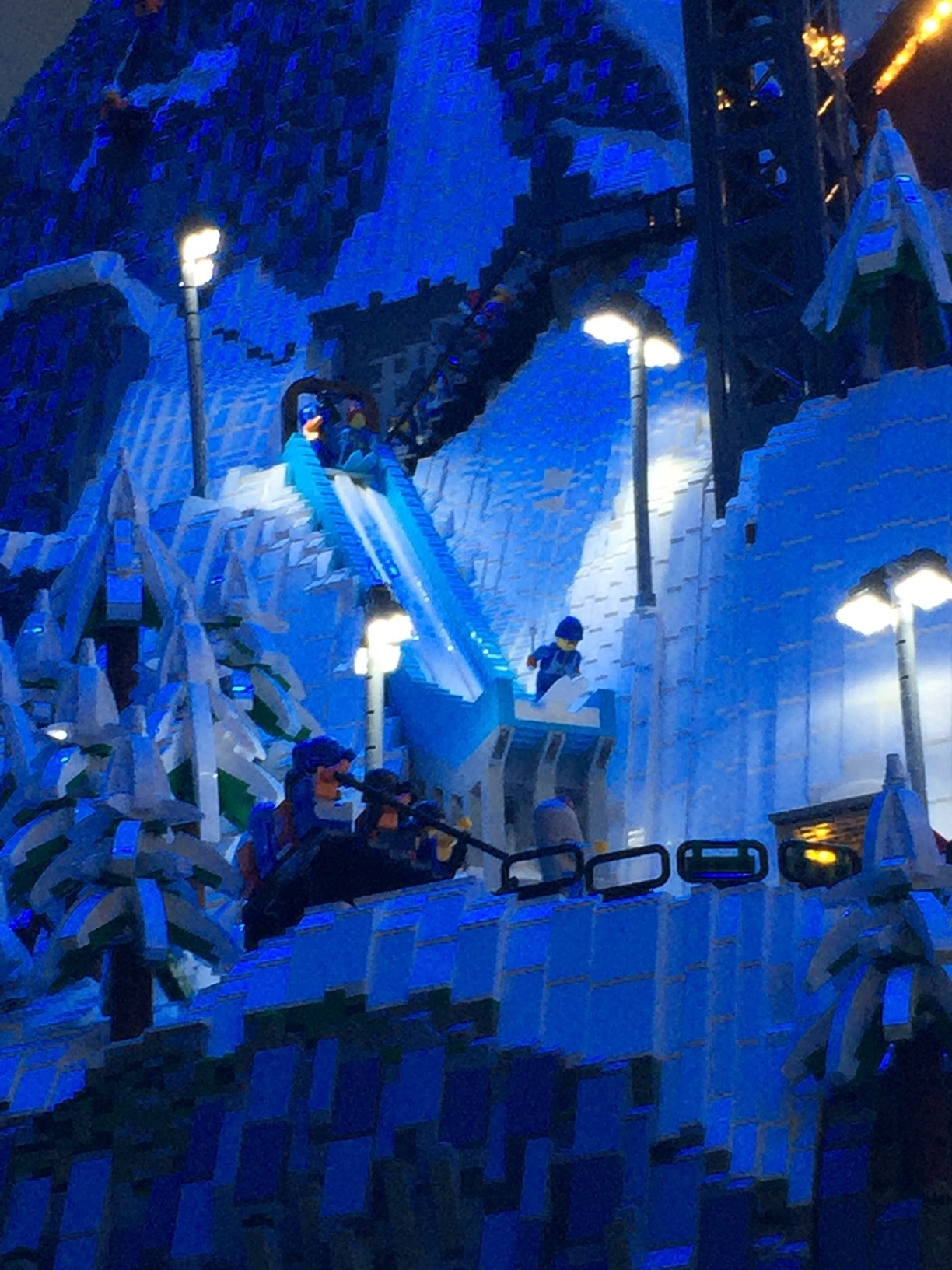A LEGO skier about to take off from a ski jump.